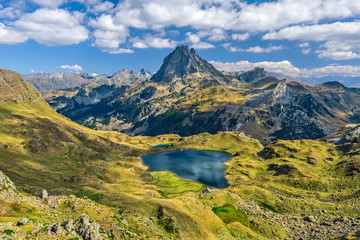 View at Ossau valley from the mountain pass Ayous in Franch Atlantic Pyrenees, as seen in October. Lake Gentau is at foreground of the famous Pyrenean peak Midi Ossau. Wall mural