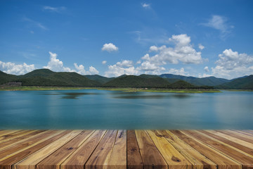 Perspective empty wood table on top over dam and mountain with blue sky in background. For products display or design layout. Fototapete