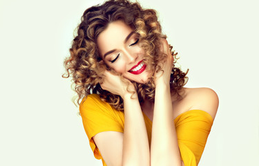 Beautiful Curly Hair. Smiling Girl With Healthy Wavy Long Blonde Hair. Portrait Happy Woman With Beauty Face, Sexy Makeup And Perfect Hair Curls. Volume, Hairstyle, Hairdressing Concept. High Quality