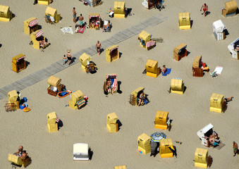 People enjoy sunbathing at a beach by the Baltic Sea in Travemuende
