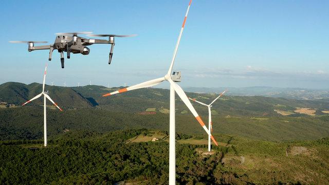 Drone inspecting wind turbine