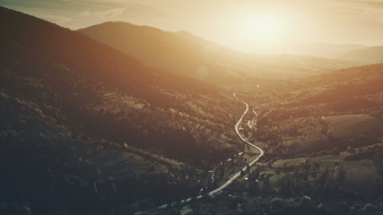 Sunset Hill Scenery Mountain Village Aerial View. Highland Slope Coniferous Forest. Scenic Wild Nature, Evergreen Fir Tree, Eco Friendly Environment. Travel Destination Drone Flight