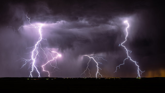 A thunderstorm moves over a small town and puts on a huge lightning show.