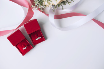 Wedding rings with bouquet of flowers