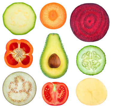 Isolated vegetable slices. Collection of fresh cut vegetables (zucchini, carrot, beetroot, bell pepper, avocado, cucumber, eggplant, tomato, potato) isolated on white background with clipping path
