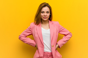 Young fashion business woman confident keeping hands on her hips.