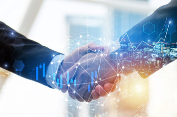 business man investor handshake with global network link connection and graph chart stock market diagram and city background, digital technology, internet communication, teamwork, partnership concept Wall mural