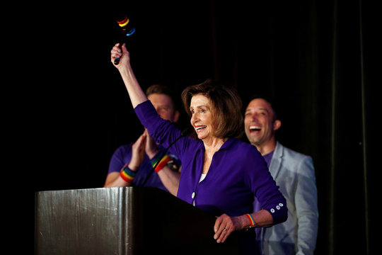 U.S. House Speaker Nancy Pelosi holds a rainbow-colored gavel during the Alice B. Toklas Club Annual Pride Breakfast in San Francisco
