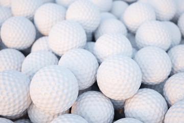 Zelfklevend Fotobehang Golf Golf balls group heap closeup