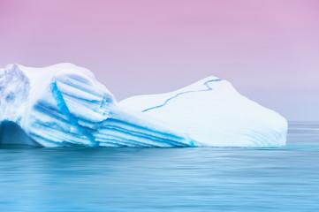 Beautiful iceberg in the Atlantic ocean at sunset. Ilulissat ice fjord, western Greenland