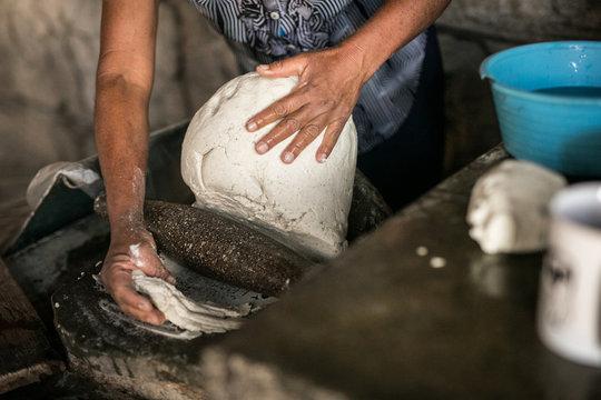 Hands making tortillas
