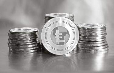 LEOcoin (LEO) digital crypto currency. Stack of silver coins. Cyber money.