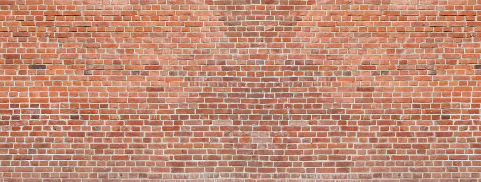 Old red brick wall background. Panoramic wide texture