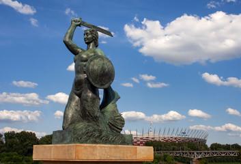 Obraz Pomnik Syreny w Warszawie na Powiślu, w tle Wisła i Stadion Narodowy - fototapety do salonu