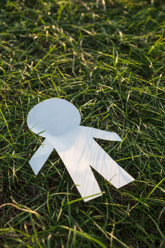 human symbol lie on the grass.