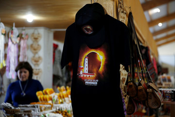 A shirt with a picture of the solar eclipse is for sale in a store in Coquimbo