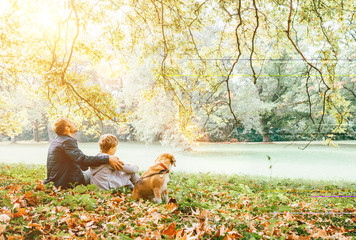 Fototapete - Father with son walk with beagle dog and enjoy warm autumn day