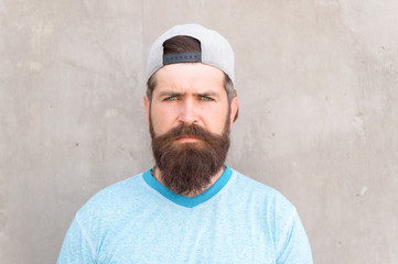 Beard and mustache grooming. Hipster lifestyle. Cool hipster with beard wear stylish baseball cap. Brutal handsome mature hipster man. Bearded man trendy style. Barber salon and facial hair care