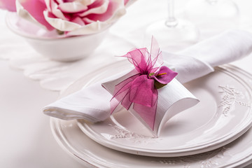Beautiful table setting with small present for the guest