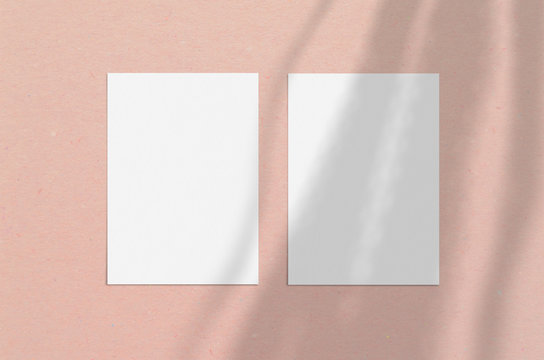 Blank white vertical paper sheet 5x7 inches with shadow overlay. Modern and stylish greeting card or wedding invitation mock up.