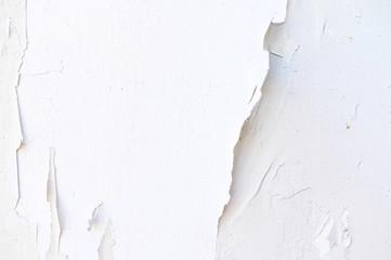 Old plaster walls, paint peeling.