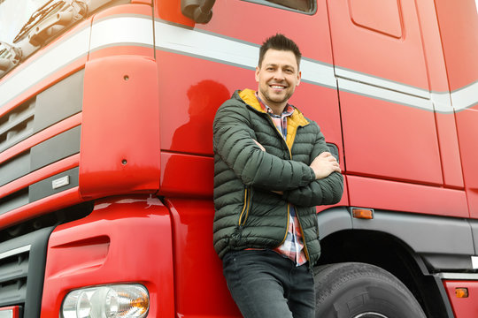 Portrait of happy driver at modern truck outdoors