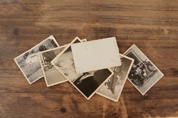 Retro some old photos on old natural wooden table