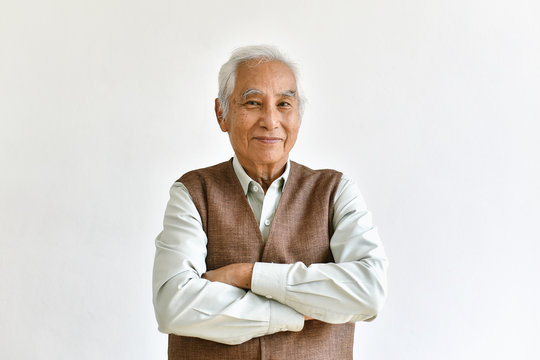 Asian senior old man, Confident and smiling elderly people with folded arms gesture on white background, Happy retiree citizen concept.