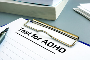 Test for ADHD form with pen and clipboard.