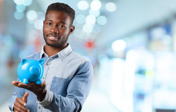 Businness black man with piggy bank. Money saving concept