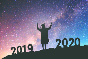 2020 New year Silhouette people graduation in 2020 years education congratulation concept background on  the Milky Way galaxy