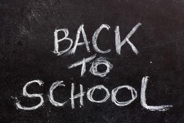 Back to school text on blackboard