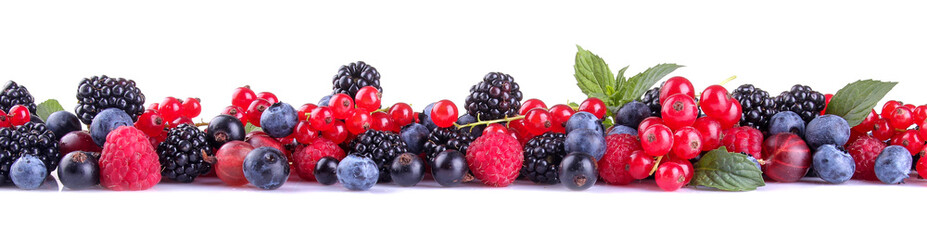 Tasty berries, currants, blackberries, blueberries, raspberries on a white isolated background