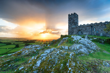 Wall Mural - Dramatic sunset over the church on the top of Brentor on Dartmoor National Park in Devon