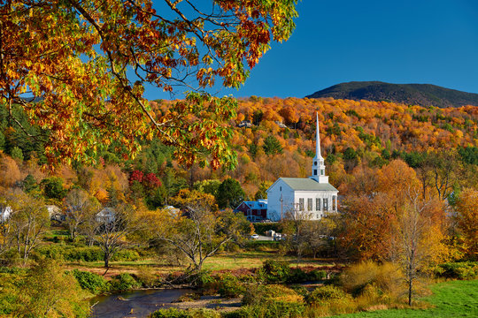 Iconic New England church in Stowe town at autumn in Vermont, USA