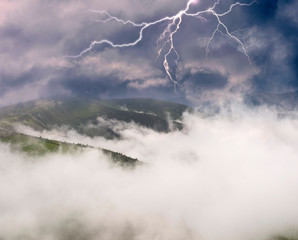 Wall Mural - morning thunderstorm in the alps