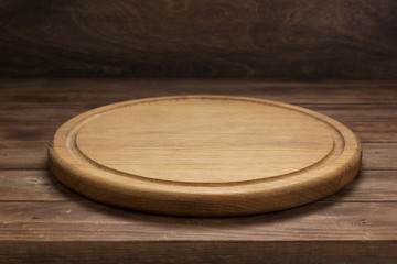 pizza cutting board at rustic wooden table in front Wall mural
