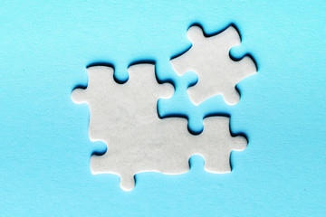Wall Mural - White details of puzzle on a blue background