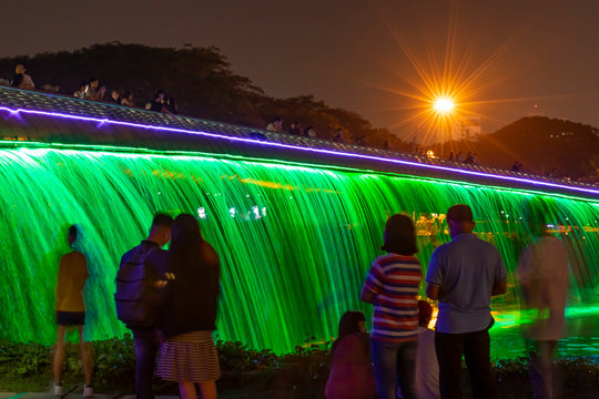 People enjoying the Starlight Bridge or anh sao bridge in phu my hung district of Ho Chi Minh City Vietnam. It is a solarpowered illuminated waterfall and pedestrian bridge & popular attraction
