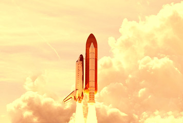 Fotorolgordijn Nasa Powerful rocket is flying through the clouds to stars. Elements of this image furnished by NASA.