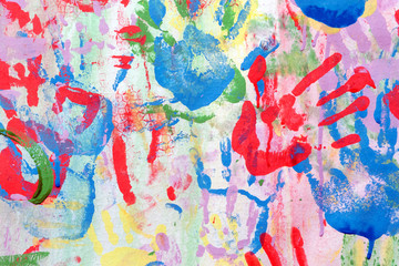 Color background of children's handprints. Multi colored hand prints