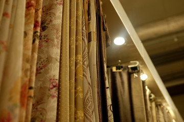 Rolls of fabric and textiles in store