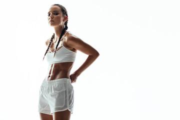 Sporty woman in studio
