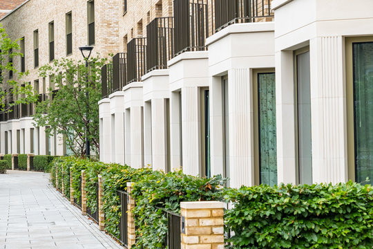 A street of modern British terraced houses