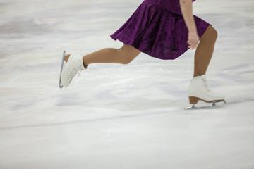 Figure skating, ice skating training. Feet skater on the ice