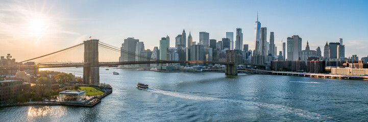 Fototapeten New York New York City skyline panorama at sunset with Brooklyn Bridge
