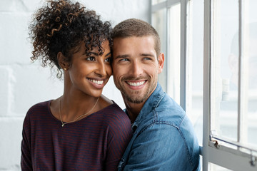 Loving multiethnic couple thinking
