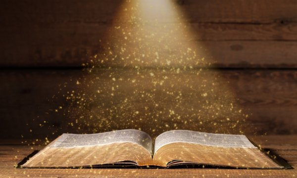 Open bible on desk.