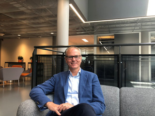 Tele2 Chief Executive Anders Nilsson poses for a picture at the brand's pocket-sized shop at its headquarters in Stockholm