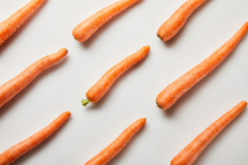 flat lay with fresh carrots on white background
